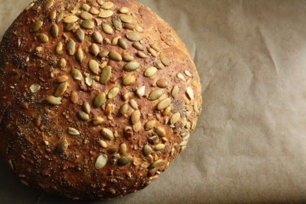 Whole Foods Seeduction Bread. A hearty, nutty, seedy whole grain bread filled with bulgur, poppy seeds, millet, pumpkin and sunflower seeds. Perfect for eating plain, toasted, slathered with butter, peanut butter or jam, torn off in hunks and dipped in hummus, served alongside salad or soup, as sandwich bread or for egg-in-a-hole. This recipe produces almost an exact replica of the Whole Foods Seeduction. Allow for  three hour rising time.  From squirrel bread.