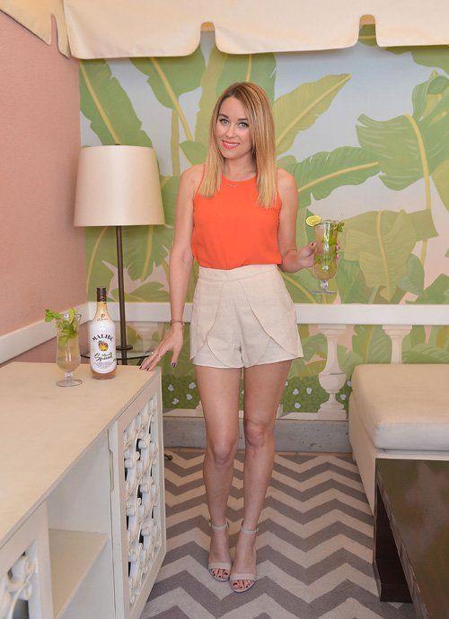 Shop Lauren Conrad's look for $60:  http://lookastic.com/women/looks/orange-tank-and-beige-shorts-and-beige-sandals/1499  — Orange Tank  — Beige Shorts  — Beige Sandals