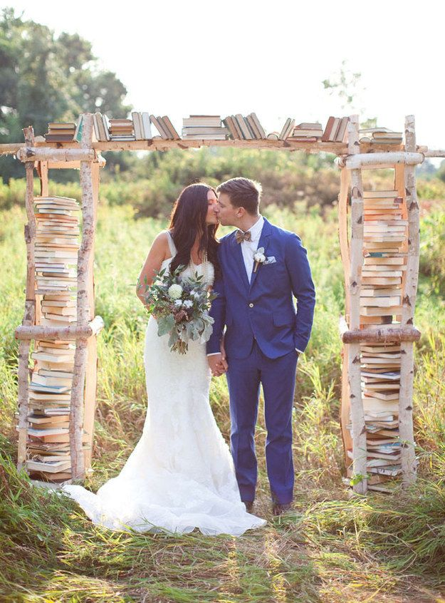 Kiss under a book-filled arch. | 27 School-Themed Wedding Ideas To Satisfy Your Inner Nerd