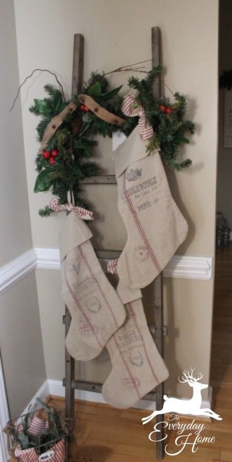 Love the Christmas decor use of a vintage ladder, burlap stockings and a touch of red