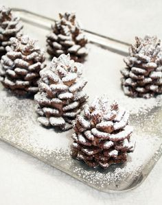 These snowy chocolate pinecones made from Nutella and cereal are a yummy snack and a fun craft for kids. No baking required!
