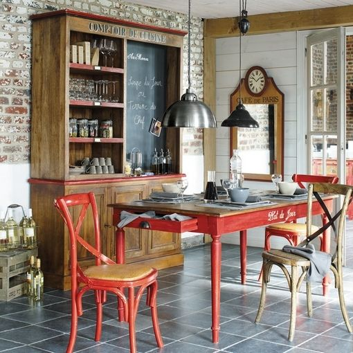 Brick in the interior, red accents, wood texture to warmify the brick