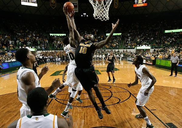 Missouri forward Ricardo Ratliffe, 10, goes up for a rebound against Baylor 's Quincy Miller, 30, in the second half of an NCAA basketball game Saturday, Jan. 21 in Waco, Texas. Photo by TONY GUTIERREZ / THE ASSOCIATED PRESS.