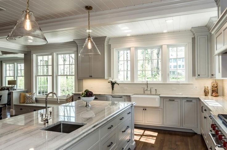 We were happy to provide the finishing touch--White Macaubas quartzite countertops.