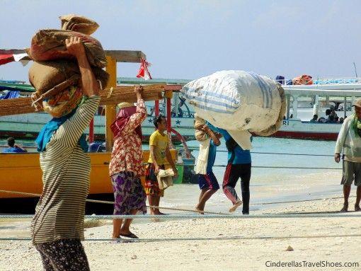 Women work hard in the harbor of Gili Trawangan