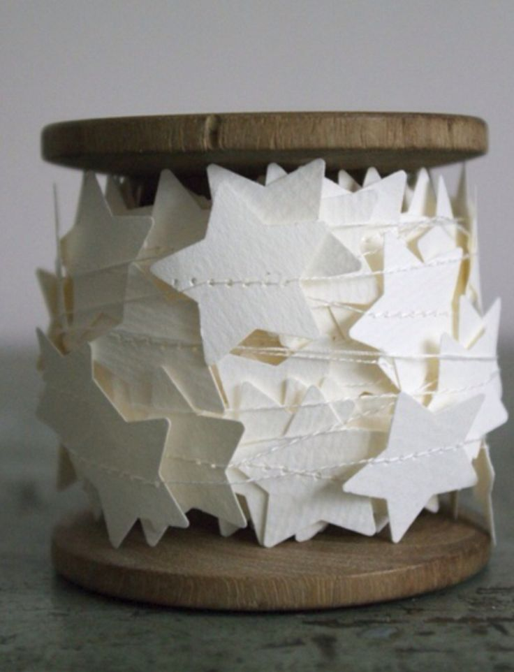 White star garland on wooden spool