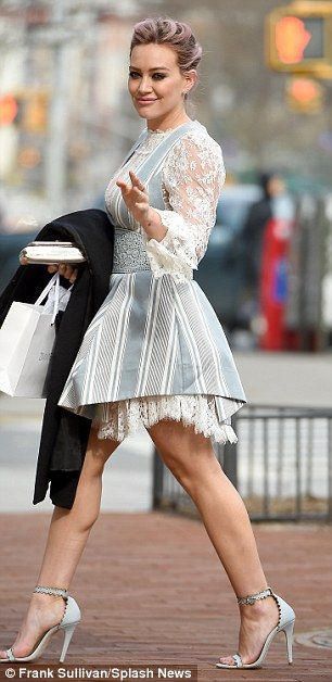 Lacy lady: Hilary's dress had a lace underskirt which dropped just below the hemline of the blue and white layer of the frock