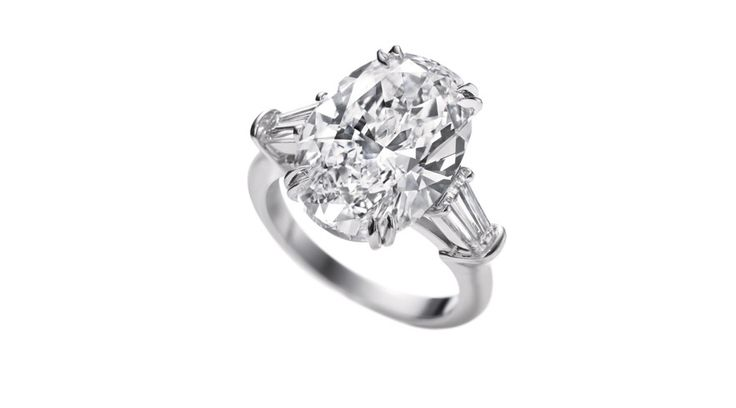 Classic Winston platinum diamond solitaire by Harry Winston, set with baguette diamonds and a single oval-cut diamond of 2.01 carats