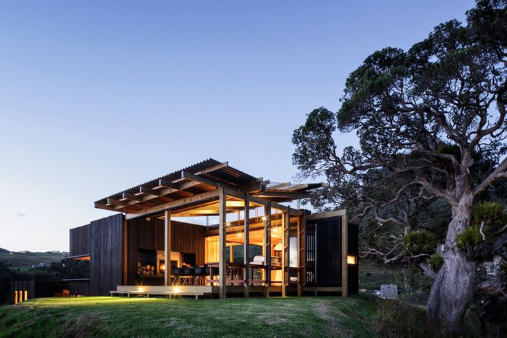 like this rustic mix of timber and dark cladding. Has a beach house feel