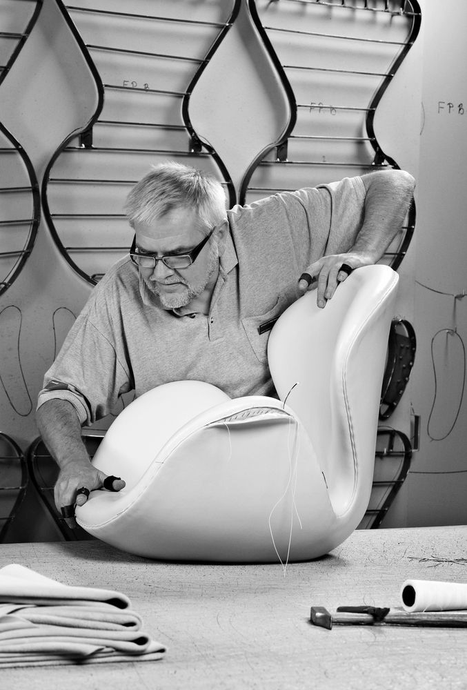 Renowned Danish designer Arne Jacobsen creating his famous Swan Chair.