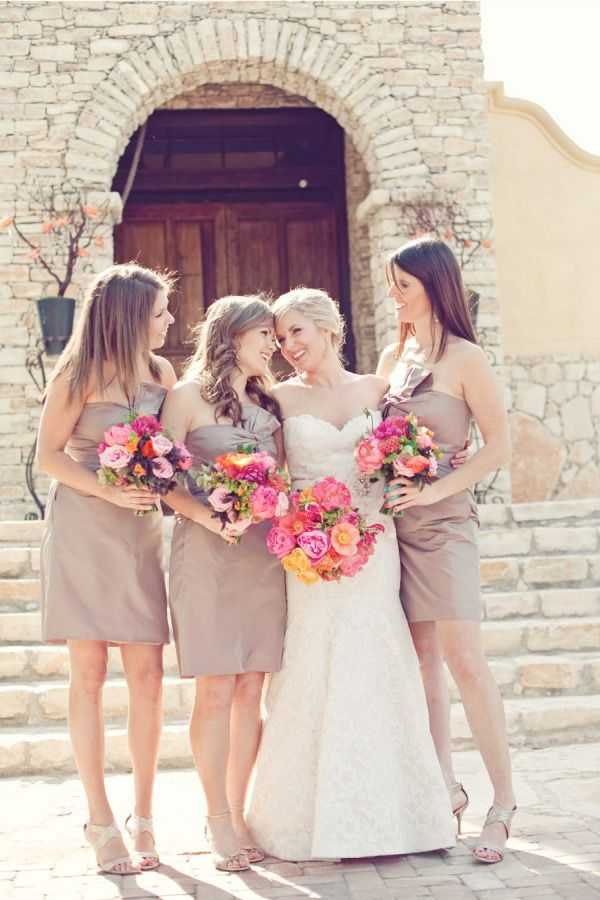 i really like neutral dresses with bright colorful flowers in the wedding colors!