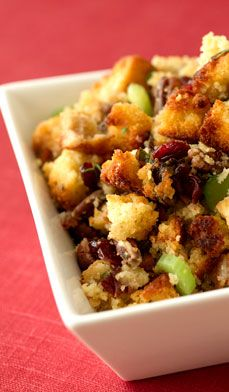 Cornbread Stuffing with Dried Cranberries - This scrumptious side dish combines the rich flavor of cornbread with the boldness of dried cranberries and savory herbs.