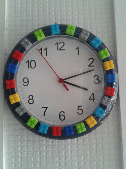 regular clock and glue Legos to it :)) love it and perfect DIY for the playroom!