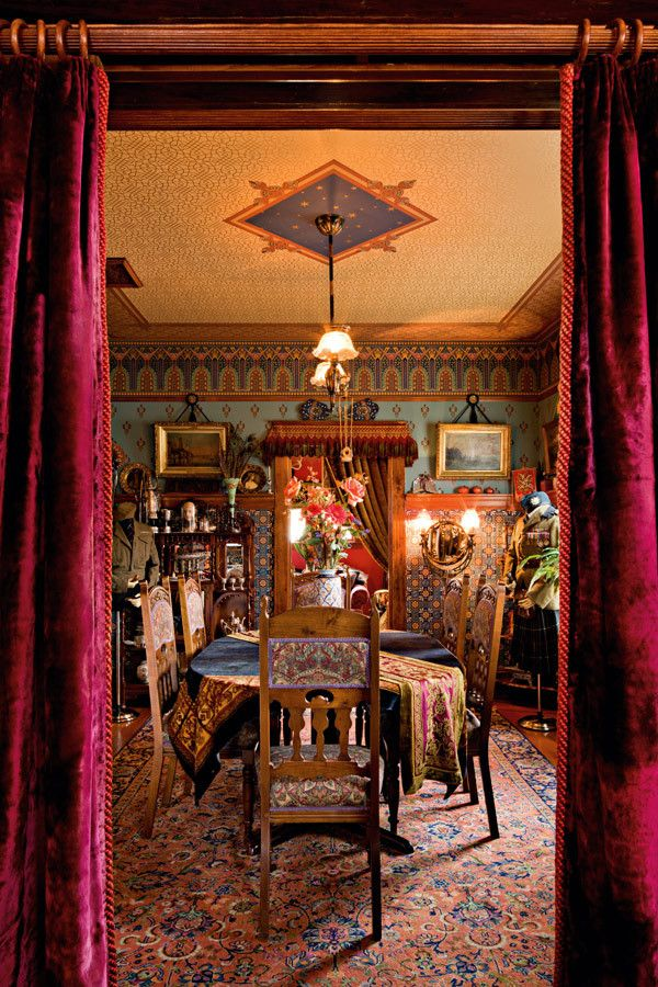 Victorian dining room with ornate wallpaper (inc. borders and medallions) on the walls & ceiling -- photo:  Lincoln Barbour