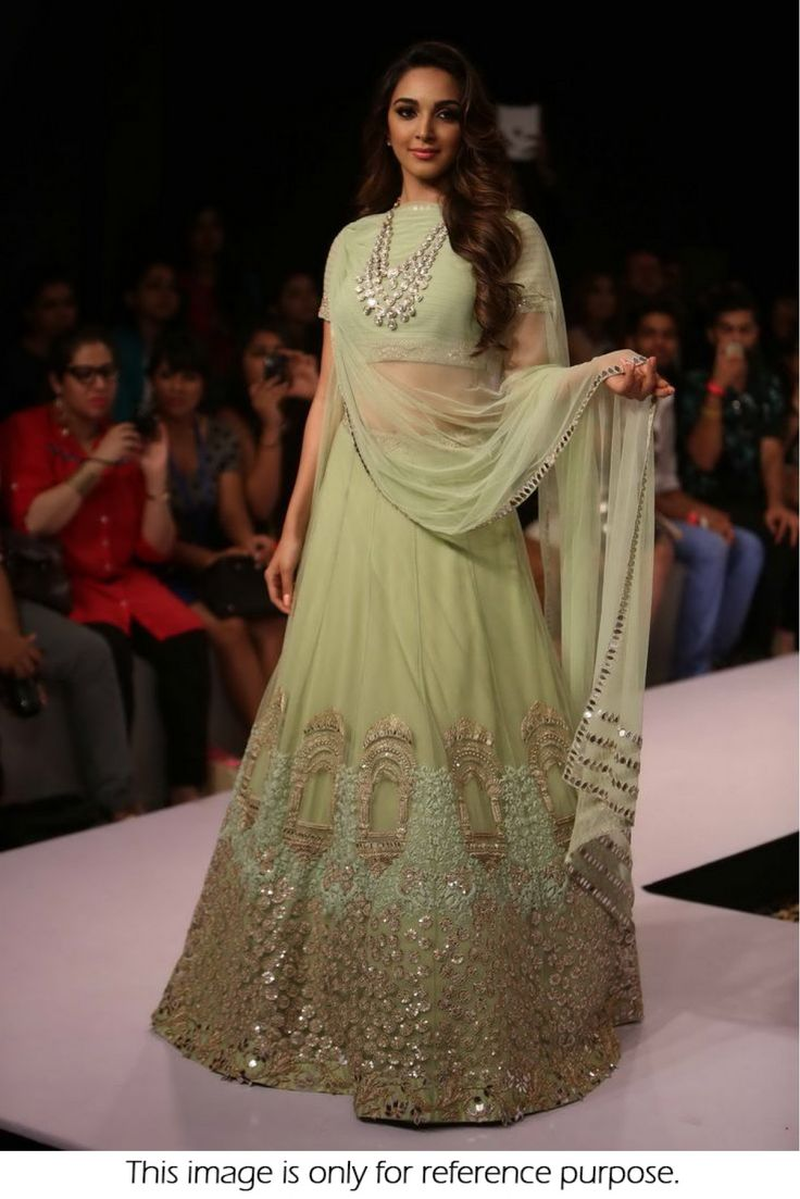 Bollywood Style Kiara Advani Net Lehenga In Sea Green Colour NC1961 Sea Green Colour Net Fabric Designer Bollywood Lehenga Comes With Matching Choli and It Can Be Stitched Up To Size 42. This Bollywoo...