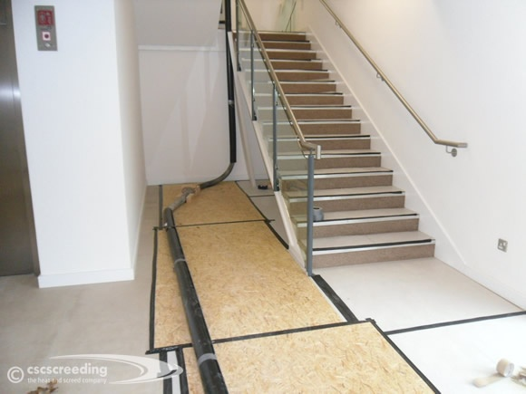 Protecting existing flooring on a screeding project against screed pump pipe movement.