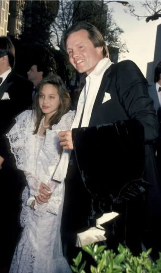 Angelina Jolie with her father Jon Voight - 1986