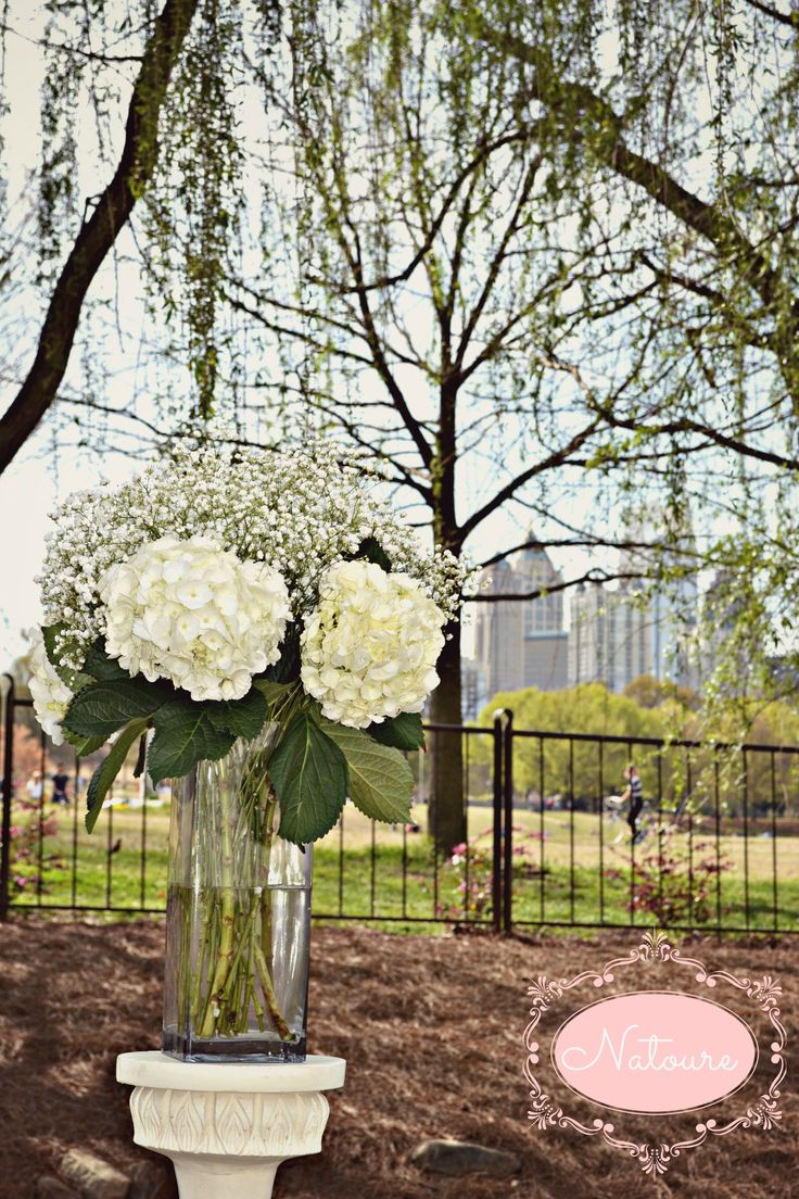 I'm finding this baby's breath and hydrangea arrangement surprisingly attractive!  white wedding flowers