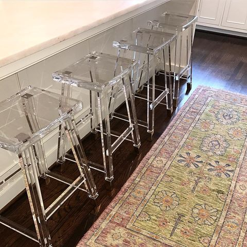 design by jenkins interiors | lucite barstools with colorful oushak rug from blue print | blueprintstore.com