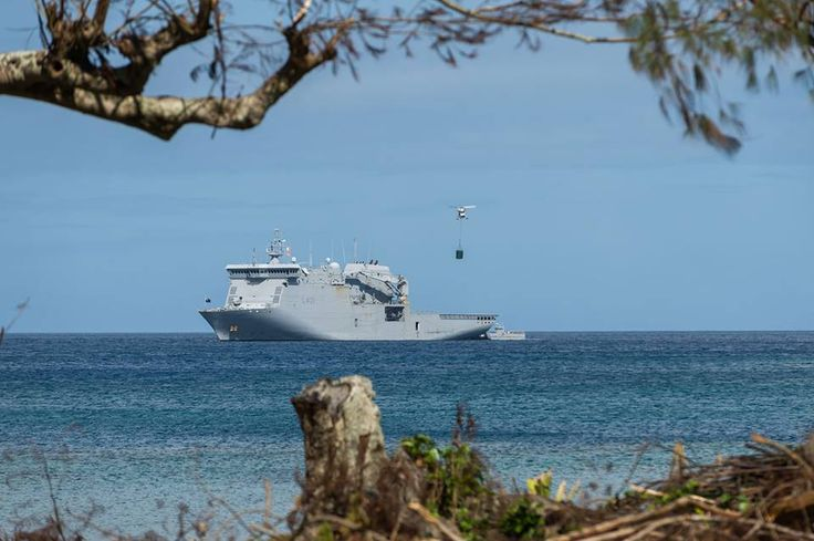 The Navy, Army and Air Force continue to combine their expertise and efforts as they focus on rebuilding Epi Island in Vanuatu  A SH-2G Sea Sprite helicopter transports a water tank from HMNZS CANTERBURY to the Lamen Bay school on Epi Island in Vanuatu.