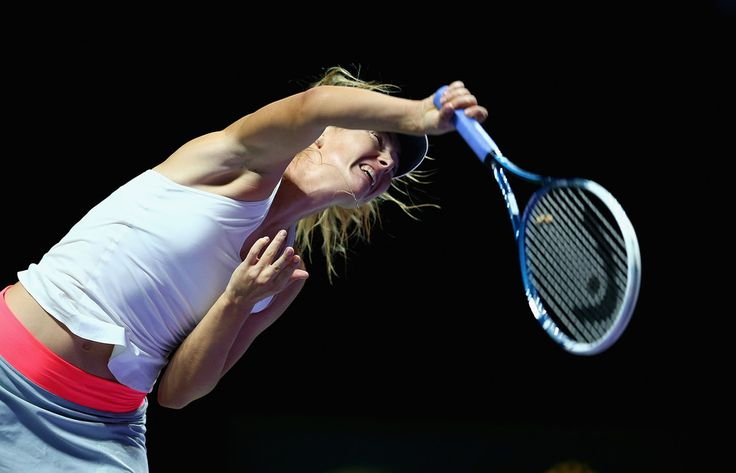 Maria Sharapova Photos: BNP Paribas WTA Finals: Day 4. Maria Sharapova of Russia serves against Petra Kvitova of the Czech Republic in their round robin match during the BNP Paribas WTA Finals at Singapore Sports Hub on October 23, 2014 in Singapore.