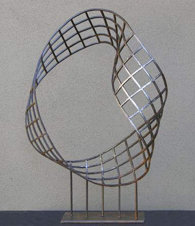 After Escher was the first in a series of sculptures celebrating the mobius strip by sculptor Kevin Caron.