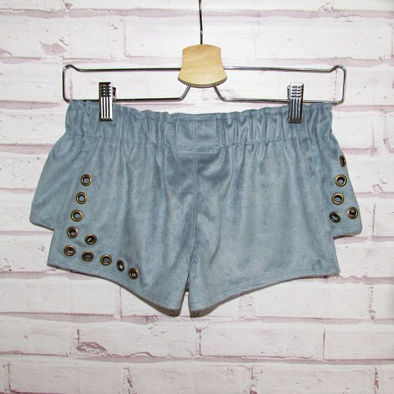 Women shorts are made of blue eco-suede. They are very stylish and look interesting. They are decorated with metal fittings by hand. You can wear it in spring or in hot summer. Shorts look great with T-shirts, and with classic shirts, so your imagination is not limited :) Size: XS-S, girl on picture: hips 88 cm/34,6 waist 60 cm/23,6 Depending on the settings of your monitor, the color may vary. Before buying, please read the store rules. If you have any questions - please not to h...