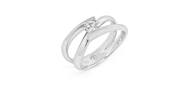 Inspired Infinity Delicate Diamond Ring.   Based on Infinity Diamond Ring and taking inspiration from the symbol for Infinity, the delicately woven platinum band of Infinity Delicate embraces a round brilliant cut diamond in an open tension set style. The technically difficult setting allows the full diamond to be viewed, lending a modern look to a classic symbol.  A round brilliant cut diamond is delicately woven in this continuous line of platinum.