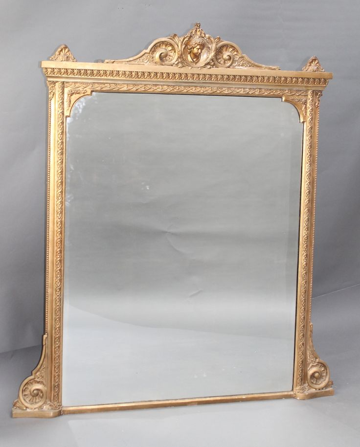 "Lot 952, A 19th Century rectangular plate mirror contained in a decorative gilt frame surmounted by a portrait bust of a classical man 60""h x 45 1/2"", est £120-160"