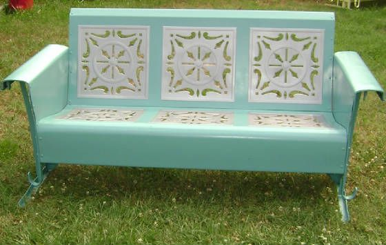 DYING to have a vintage glider like this.  Love the detailed pattern and soft colors.