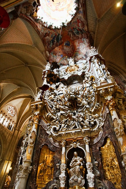 Toledo Cathedral. Although construction began around 1200 in the gothic style, the cathedral took centuries to build, and areas within were later decorated to suit whichever style was popular at the time, including the baroque. El Transparente is one example, with its ornate design. The window overhead is a hole in the stone, allowing light to fall on the baroque sculpture inside the otherwise gothic structure, as if from heaven.
