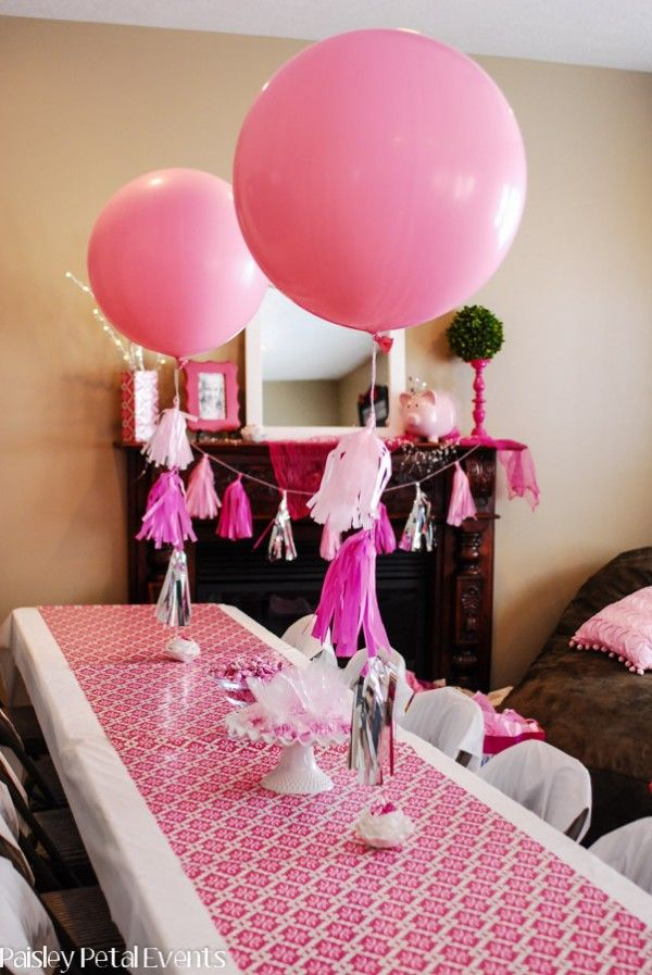 tissue tassels on balloons as centerpieces