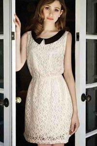 Koronkowa sukienka w stylu retro. Więcej na www.vintageclothes.pl