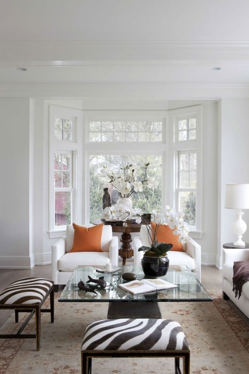 Staging with Meridith Baer | White with a pop of orange and animal print. via Bungalux.com
