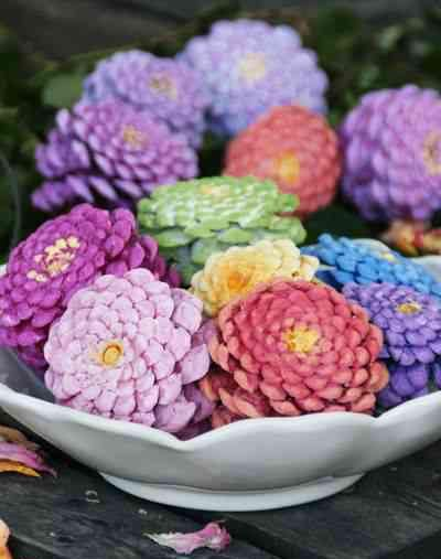 Here's a new use for pinecones! This colorful project is great for spring and summer decor. Just paint the bottoms in bright colors with a yellow center, then group together like a bouquet of zinnias.