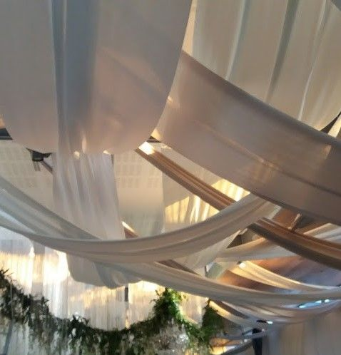 Criss-crossing strip draping for ceiling draping at Cavalli Estate wedding. www.eventsdraping.co.za