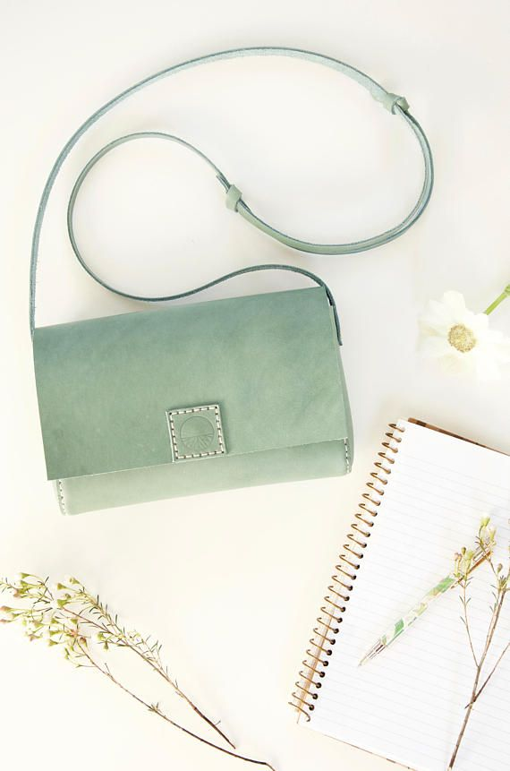 This small, sweet purse is made of gorgeous, vegetable tanned Italian leather in a beautiful pastel hue. Somewhere between sage and mint, the bluish green tint of the leather is absolutely perfect for spring and summer.
