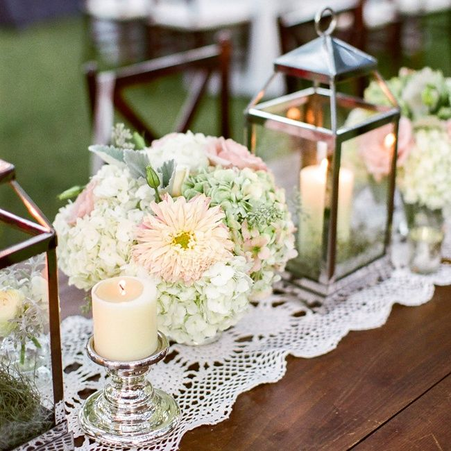 Low pastel centerpieces with candle lanterns