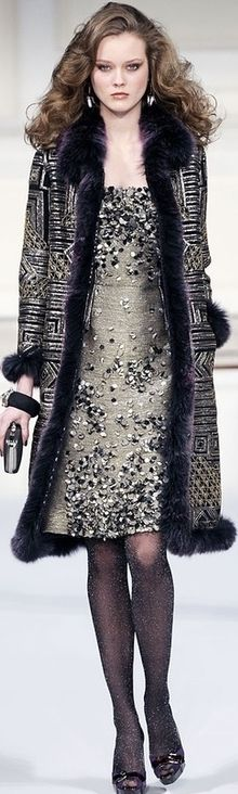 Oscar de la Renta---living the hair!  I see hair like that on runways but when will it trickle down to the streets?