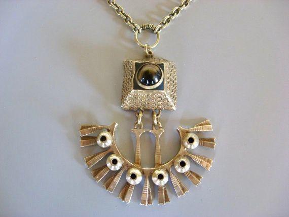 """Pentti Sarpaneva for Kalevala Koru (FI), mid-century modernist bronze necklace with a tiger's eye cabochon, 1960s. | buy here • Pentti Sarpaneva • Turun Hopea """