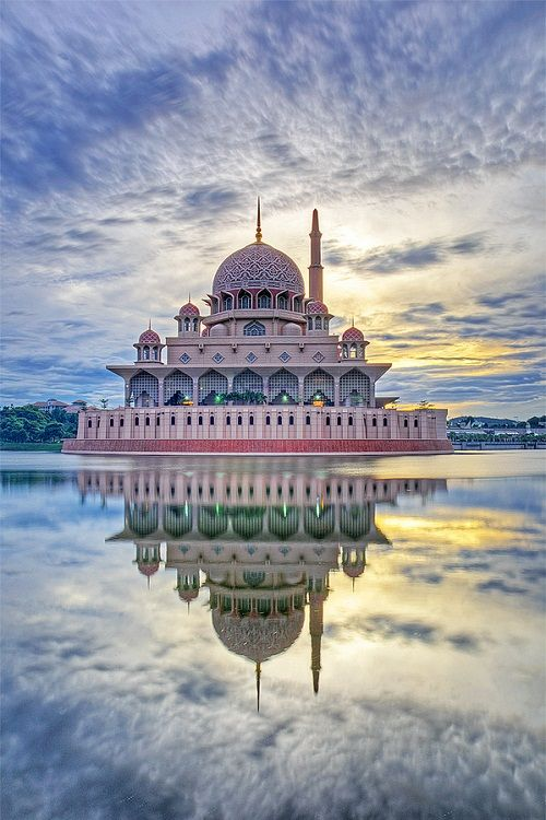 reflecting beauty: The Putra Mosque, or Masjid Putra in Malay language, is the principal mosque of Putrajaya, Malaysia. Construction of the mosque began in 1997 and was completed two years later.