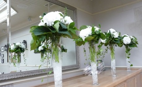 Wedding ceremony set-up at the Hotel Du Vin Brighton    Tall flute vases of ice decked with fluffy white hydrangea and scented garden