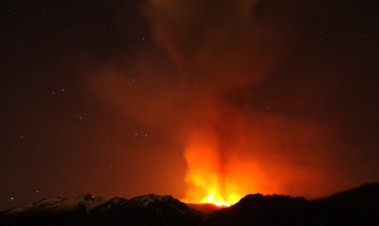 Mount Etna spews volcanic ash during an eruption on the southern Italian island of Sicily, on April 1, 2012. Mount Etna is Europe's tallest and most active volcano. (Reuters/Antonio Parrinello)