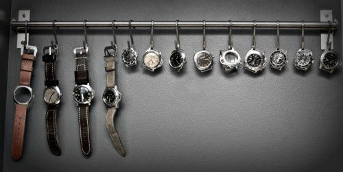 DIY Watch Rack - use a towel rack and S hooks to display watches. Perfect to keep track of all those interchangeable parts!