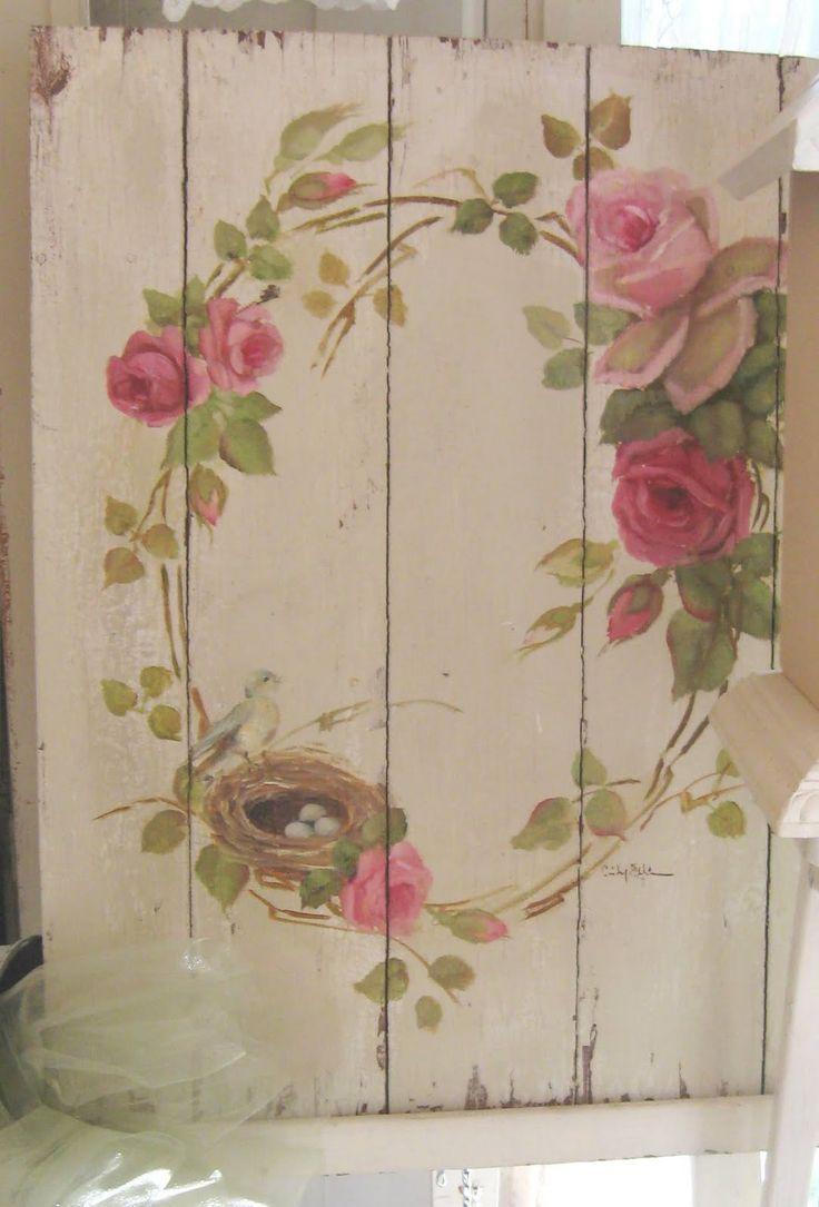 Beautiful shabby romantic chic roses on white weathered wood.