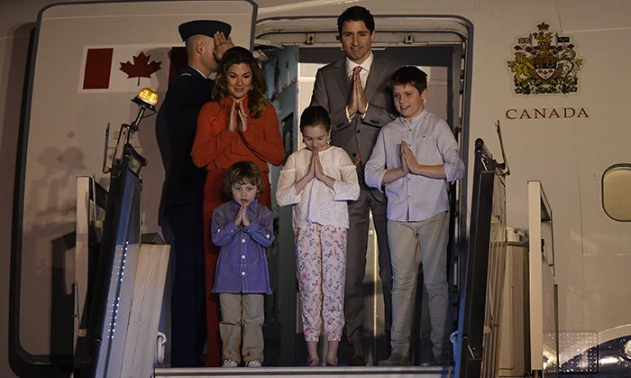 """Namaste! Justin Trudeau and his wife Sophie Grégoire Trudeau kicked off a week-long tour of India with their kids with a traditional bow as they disembarked in New Delhi on Saturday, Feb. 17. """"Wheels up for India and a busy visit, focused on creating good jobs and strengthening the deep connection between the people of our two countries,"""" he said on Twitter. The Prime Minister and his family will visit a number of popular sites in addition to his participation in meetings and round tables…"""