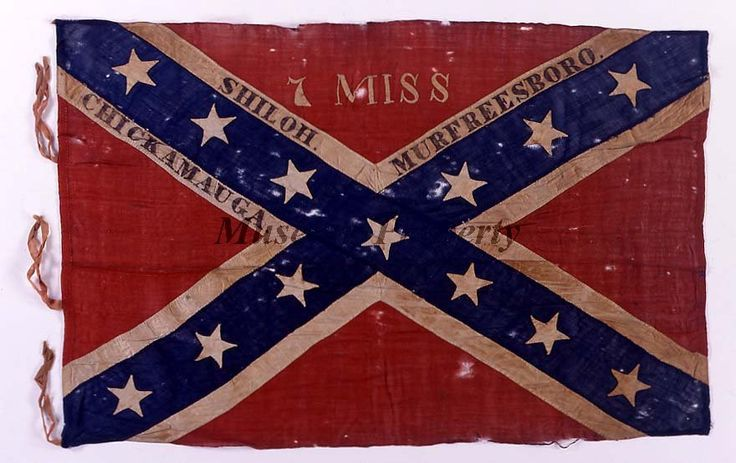 """Pattern: Army of Tennessee battle flag. Unit Designation: In white appliqué, """"7 MISS"""" Battle Honors: In black paint, """"SHILOH"""", """"CHICKAMAUGA"""", and """"MURFREESBORO"""".Requisitioned in January 1864 by Lt. Col. Benjamin Franklin Johns. Captured at the battle of Jonesboro, GA-1864 by Capt. John A. Smith, 57th Ohio Veteran Volunteer Infantry. The flag had been presented to Mr. Dawson, the donors' father, """"by a Confederate soldier, who broke the window of a store in Bellefontaine, OH, and recaptured…"""