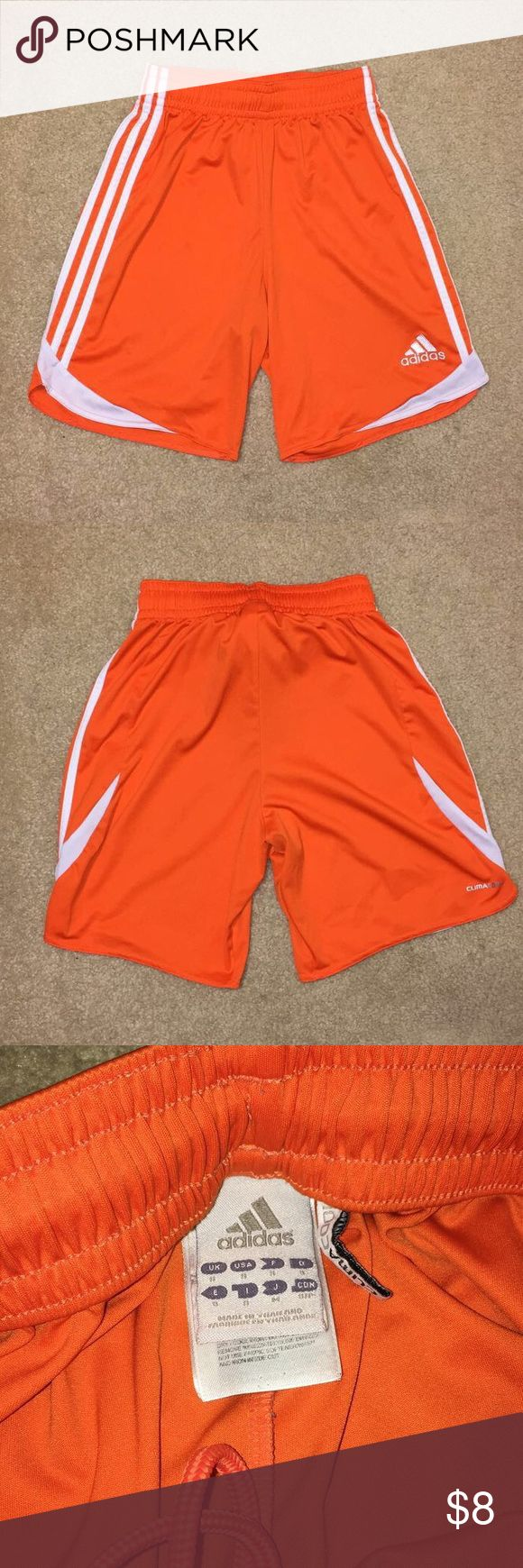 Orange Adidas Soccer shorts Soccer shorts from adidas, orange in color, size small. Two small spots on shorts as pictured, honestly not very noticeable in person. Open to offers :) adidas Shorts Athletic