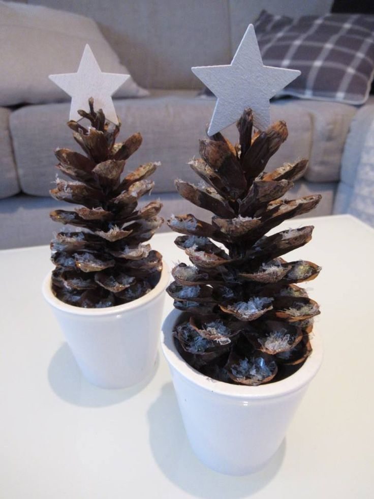 DIY tiny snowy Christmas trees made from pine cones