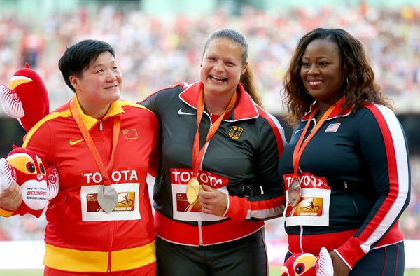(L-R) Silver medalist Lijiao Gong of China, gold medalist Christina Schwanitz of Germany and bronze medalist Michelle Carter of the United States pose on the podium during the medal ceremony for the Women's Shot Put during day two of the 15th IAAF World Athletics Championships Beijing 2015